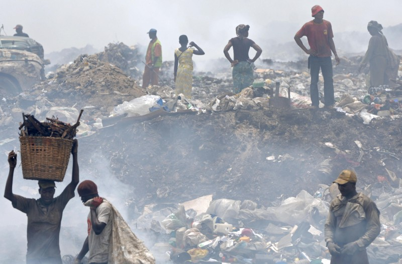 People sift through rubbish at a dump, 1