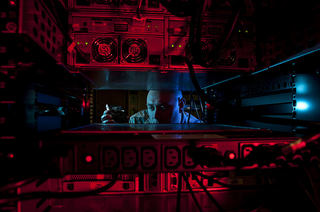 An Airman inserts a hard drive into the network control center retina server. (DoD photo)