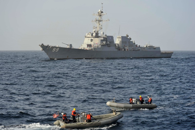 Sailors approach USS Farragut at sea.