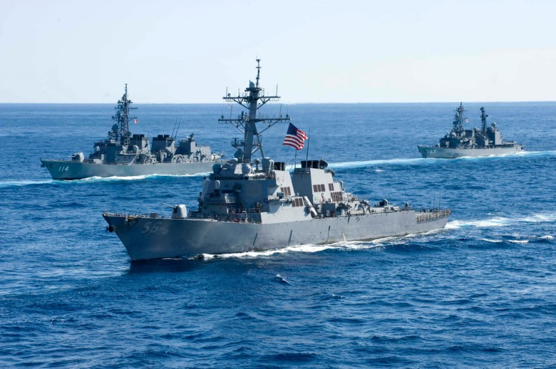 U.S. and Japanese warships underway in the Pacific