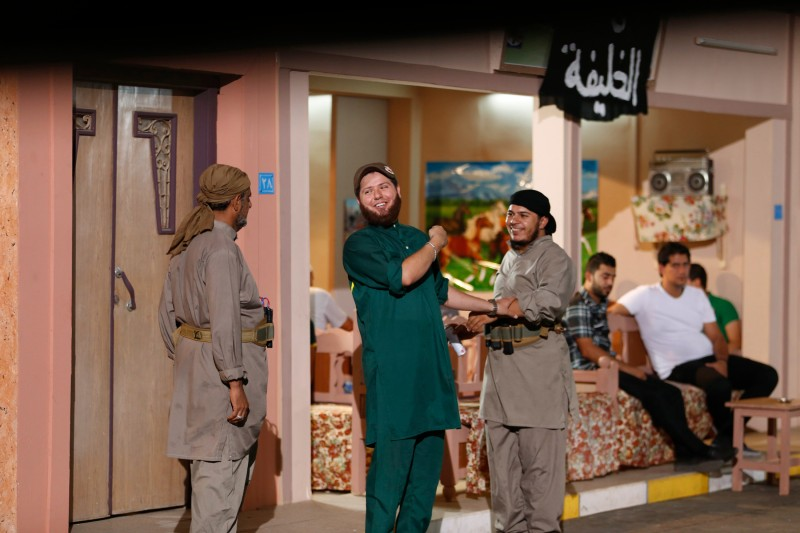 """A view shows actors during the filming of the set of the television series, whose title is loosely translated as """"State of Myths"""" in Baghdad"""