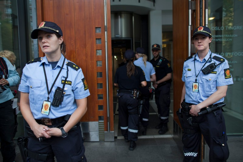 OSLO, NORWAY - JULY 25:  Norwegian police stand guard outside the court house as Anders Behring Breivik who confessed to Norway's worst act of terror appears in a closed court on July 25 ,2011 in Oslo, Norway. So far seven people have been confirmed dead from the bomb attack and 86 on Utoya. Although Norwegian Anders Behring Breivik has confessed to the killings, claiming that he acted alone, he has not pleaded guilty.  (Photo by Paula Bronstein/Getty Images)
