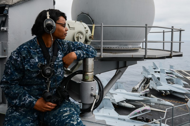 140808-N-OR184-043 PACIFIC OCEAN (Aug. 8, 2014) Seaman Leslie Gatlin, from Chicago, stands the lookout watch observing helicopter operations aboard the aircraft carrier USS Ronald Reagan (CVN 76). (U.S. Navy photo by Mass Communication Specialist 3rd Class Emiline L. M. Senn/Released)