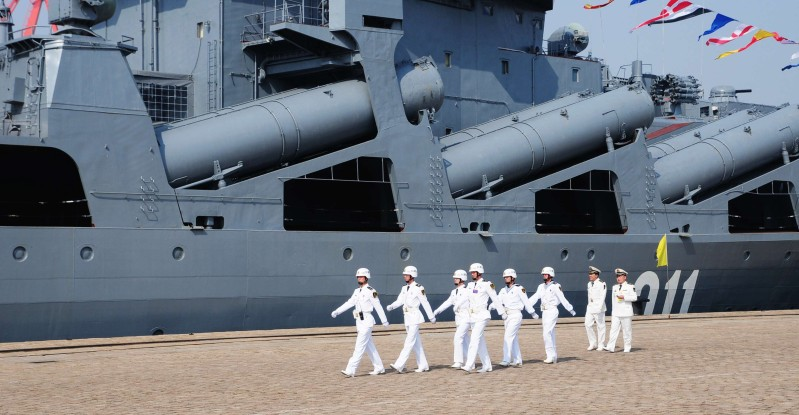 Chinese sailors march pass the Russian destroyer Admiral Vinogradov berthed at the People's Liberation Army (PLA) naval base in Qingdao, northeastern China's Shandong province on April 23, 2012, prior to the start of the Sino-Russian joint naval exercises.  China and Russia launched their first joint naval exercises, with war games in the Yellow Sea that come amid tensions between China and its Asian neighbours over territorial claims.         CHINA OUT      AFP PHOTO        (Photo credit should read STR/AFP/GettyImages)