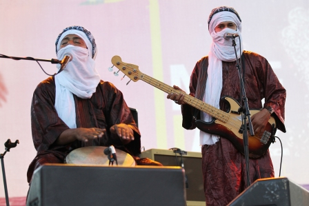 Tuareg Tinariwen ban performs on the stage of the Nice's Jazz Festival on July 10, 2012 in Nice, southern France.   AFP PHOTO / VALERY HACHE        (Photo credit should read VALERY HACHE/AFP/GettyImages)