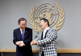 NEW YORK, NY - OCTOBER 23: South Korean singer Psy (R), whose real name is Park Jae-sang, visits UN Secretary General Ban Ki-moon at the United Nations on October 23, 2012 in New York City.  (Photo by Allison Joyce/Getty Images)