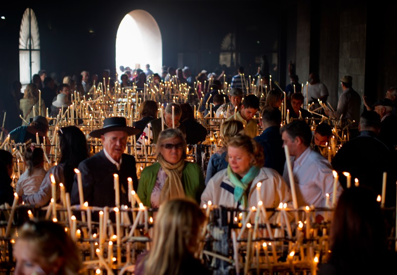 Worshipers light candles in the shrine of El Rocio in El Rocio, Spain, on May 19, 2013 .
