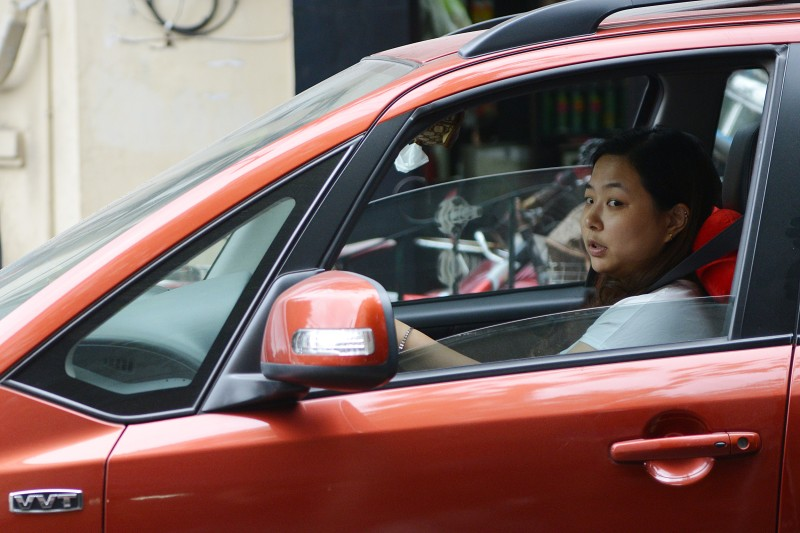 A woman drives her car on a street in Shanghai on October 30, 2013. Suggestions given by the Beijing police department to women drivers in a series of microblog postings have sparked a backlash among Chinese Internet users who say the tips are sexually discriminatory.  AFP PHOTO/Peter PARKS        (Photo credit should read PETER PARKS/AFP/Getty Images)