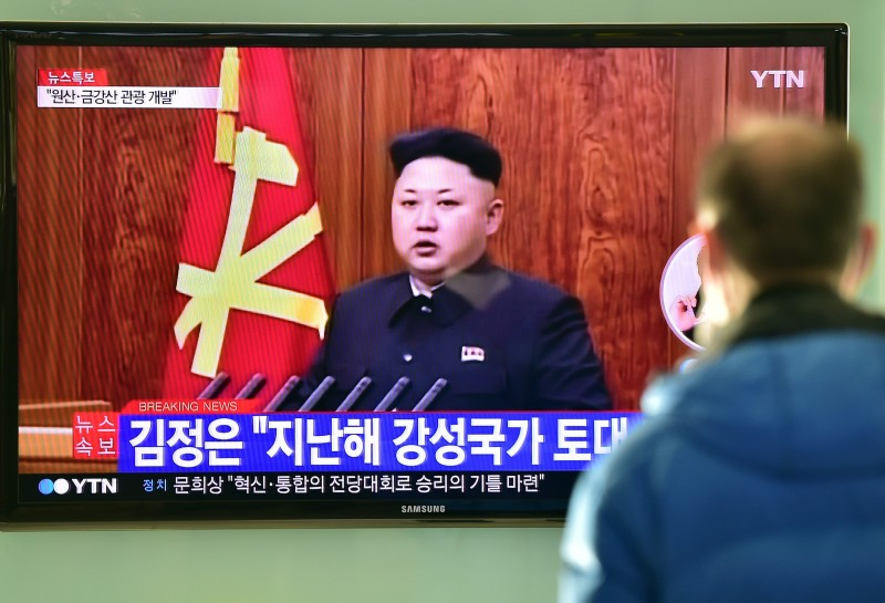 """A South Korean man watches a television screen showing North Korean leader Kim Jong-Un's New Year speech, at a railroad station in Seoul on January 1, 2015. North Korean leader Kim Jong-Un said he was open to the """"highest-level"""" talks with South Korea as he called for an improvement in strained cross-border relations.  AFP PHOTO / JUNG YEON-JE        (Photo credit should read JUNG YEON-JE/AFP/Getty Images)"""