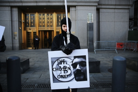NEW YORK, NY - JANUARY 13:  Max Dickstein stands with other upporters of Ross Ulbricht, the alleged creator and operator of the Silk Road underground market, in front of a Manhattan federal court house on the first day of jury selection for his trial on January 13, 2015 in New York City.  Ulbricht, who has pleaded not guilty, is accused by the US government of making millions of dollars from the Silk Road website which sold drugs and other illegal commodities anonymously.  (Photo by Spencer Platt/Getty Images)