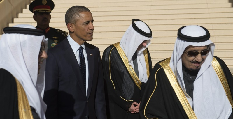 Saudi new King Salman (R) stands alongside US President Barack Obama (2nd from L) after the Obamas arrived on Air Force One at King Khalid International Airport in Riyadh on January 27, 2015. Obama landed in Saudi Arabia to shore up ties with new King Salman and offer condolences after the death of his predecessor Abdullah. AFP PHOTO / SAUL LOEB        (Photo credit should read SAUL LOEB/AFP/Getty Images)