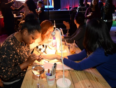 NEW YORK, NY - JANUARY 29:  Guests enjoy Smirnoff Ice and a Nail Salon at the Ladies With Game Tailgate at The Diageo Liquid Cellar on January 29, 2014 in New York City.  (Photo by Rick Diamond/Getty Images for Smirnoff Ice)