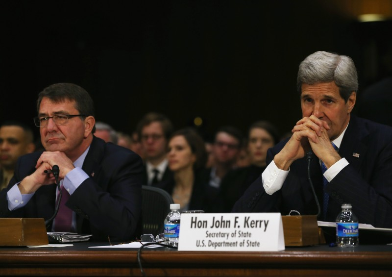 WASHINGTON, DC - MARCH 11:  Secretary of State John Kerry (R) and Defense Secretary Ashton Carter (L) listen to questions during a Senate Foreign Relations Committee hearing on Capitol Hill, March 11, 2015 in Washington, DC. The committee is hearing testimony from top administration officials on President Obamas request to Congress for authorization to use force against ISIS.  (Photo by Mark Wilson/Getty Images)