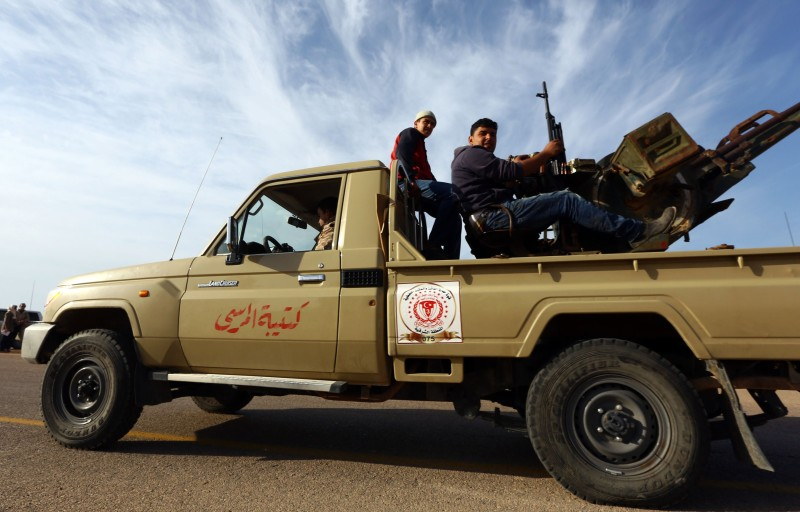 Members of a brigade loyal to the Fajr Libya (Libya Dawn), an alliance of Islamist-backed militias, sit on a pick up truck mounted with a machine gun on March 15, 2015 in Libya's coastal city of Sirte, which lies 500 kilometres (310 miles) east of the capital, Tripoli. Rare clashes between fighters from the Islamic State group and Fajr Libya erupted on March 14, 2014 in Sirte, security and militia officials said, a month after Fajr Libya said it had sent reinforcements to the city to restore security.   AFP PHOTO / MAHMUD TURKIA        (Photo credit should read MAHMUD TURKIA/AFP/Getty Images)