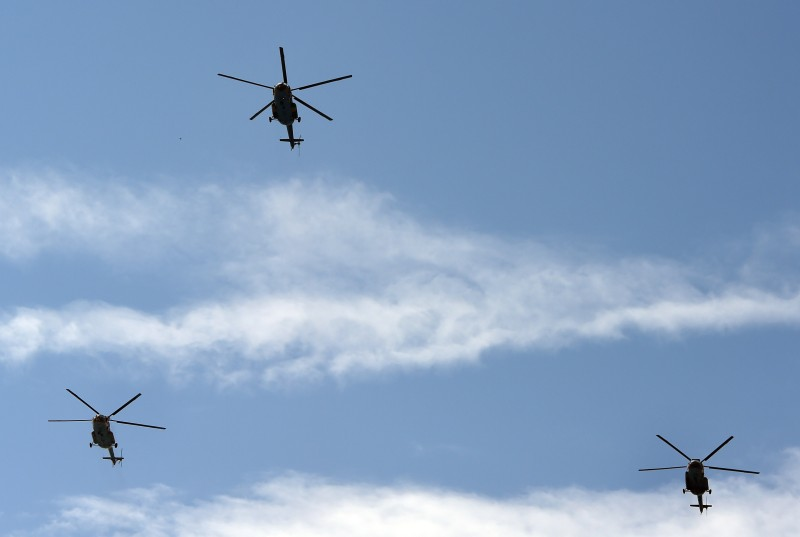 Pakistani army Mi-17 helicopters fly during a rehearsal for the National Day celebrations, in Islamabad on March 20, 2015. A joint military parade of Pakistan's armed forces will take place on Pakistan Day which falls on March 23, after a gap of seven years.  AFP PHOTO / Farooq NAEEM        (Photo credit should read FAROOQ NAEEM/AFP/Getty Images)