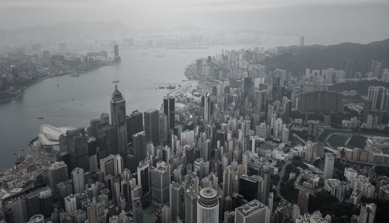 An aerial shot shows the skylines of Hong Kong island (foreground) and Kowloon (back L) separated by Victoria harbour on April 23, 2015, a day after the city's government unveiled its Beijing-backed plan for leadership elections in 2017. Britain handed Hong Kong over to China in 1997 under a joint declaration which guaranteed political, social and economic freedoms not enjoyed on the Chinese mainland.  AFP PHOTO / Philippe Lopez        (Photo credit should read PHILIPPE LOPEZ/AFP/Getty Images)