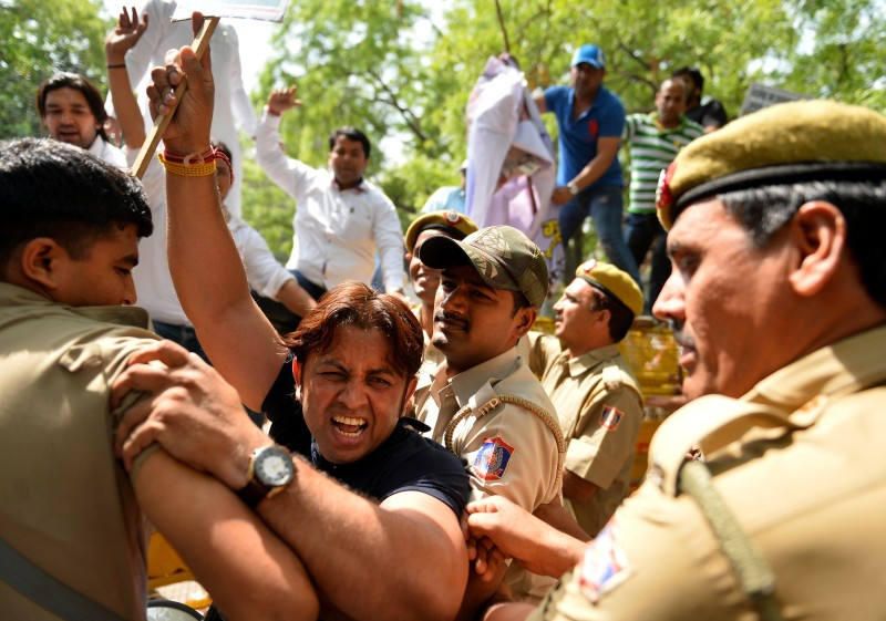 Indian supporters of the Delhi Pradesh Youth Congress shout slogans against Delhi Chief Minister Arvind Kejriwal as they clash with police outside his house during a protest against the suicide of a farmer at a rally organised by Kejriwal's Aam Admi Party in New Delhi on April 23, 2015. A farmer hanged himself in front of hundreds of protesters gathered in the centre of the Indian capital on April 22, 2015, to rally against the government's contentious reform of land purchasing laws. AFP PHOTO / Chandan KHANNA        (Photo credit should read Chandan Khanna/AFP/Getty Images)