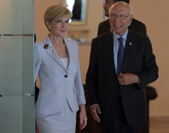 Pakistan's National Security Advisor Sartaj Aziz (R) arrives with Australian Minister for Foreign Affairs Julie Bishop at the Foreign Ministry in Islamabad on May 6, 2015.   Julie Bishop arrived in Islamabad to meet with Pakistani government officials. AFP PHOTO / AAMIR QURESHI        (Photo credit should read AAMIR QURESHI/AFP/Getty Images)