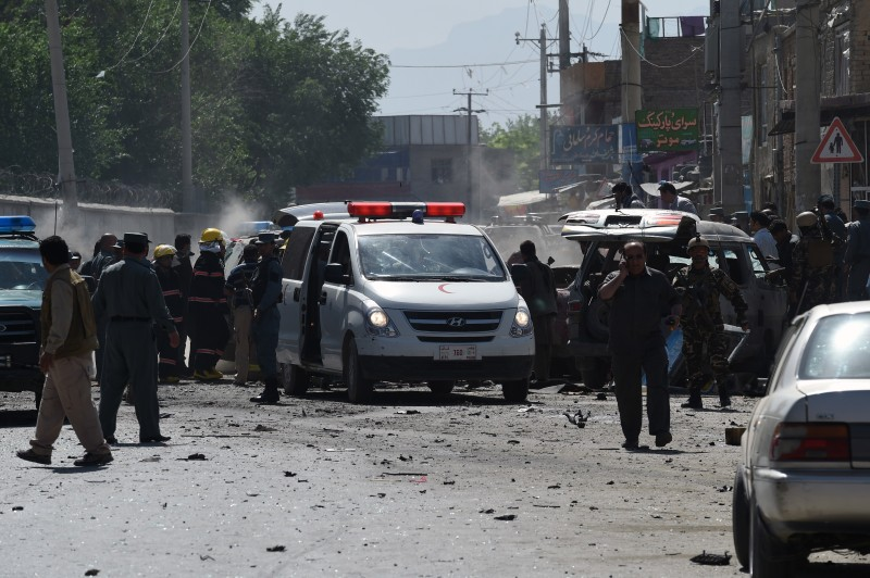 "Afghan security forces inspect the site of a suicide attack in Kabul on May 17, 2015. A powerful suicide blast struck near Kabul airport during the peak morning rush hour on May 17, with several casualties feared, an official said. ""Three civilian vehicles, one of them belonging to foreign troops are damaged at the site of the attack,"" Najib Danish, deputy interior ministry spokesman, told AFP. AFP PHOTO / SHAH Marai        (Photo credit should read SHAH MARAI/AFP/Getty Images)"