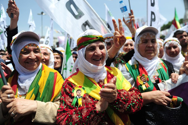 Kurdish women shout slogans and flash victory sign in the district of Bagcilar in Istanbul on May 24, 2015 during an election rally of the leader of the pro-Kurdish Peoples' Democratic Party (HDP) Selahattin Demirtas, ahead of the legislative election on June 7, 2015. AFP PHOTO / OZAN KOSE        (Photo credit should read OZAN KOSE/AFP/Getty Images)