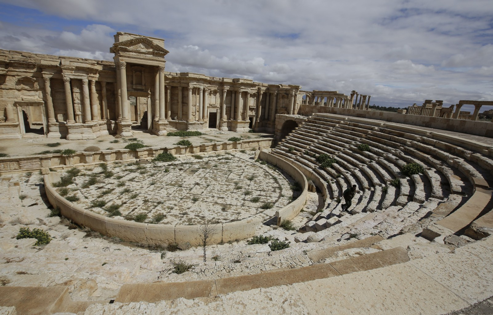 A picture taken on March 14, 2014 shows a partial view of the theatre at the ancient oasis city of Palmyra, 215 kilometres northeast of Damascus. From the 1st to the 2nd century, the art and architecture of Palmyra, standing at the crossroads of several civilizations, married Graeco-Roman techniques with local traditions and Persian influences. AFP PHOTO/JOSEPH EID        (Photo credit should read JOSEPH EID/AFP/Getty Images)