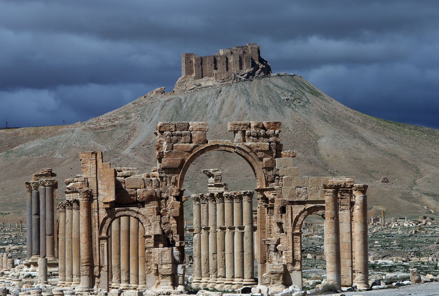 A picture taken on March 14, 2014 shows a partial view of the ancient oasis city of Palmyra, 215 kilometres northeast of Damascus. From the 1st to the 2nd century, the art and architecture of Palmyra, standing at the crossroads of several civilizations, married Graeco-Roman techniques with local traditions and Persian influences. AFP PHOTO/JOSEPH EID        (Photo credit should read JOSEPH EID/AFP/Getty Images)