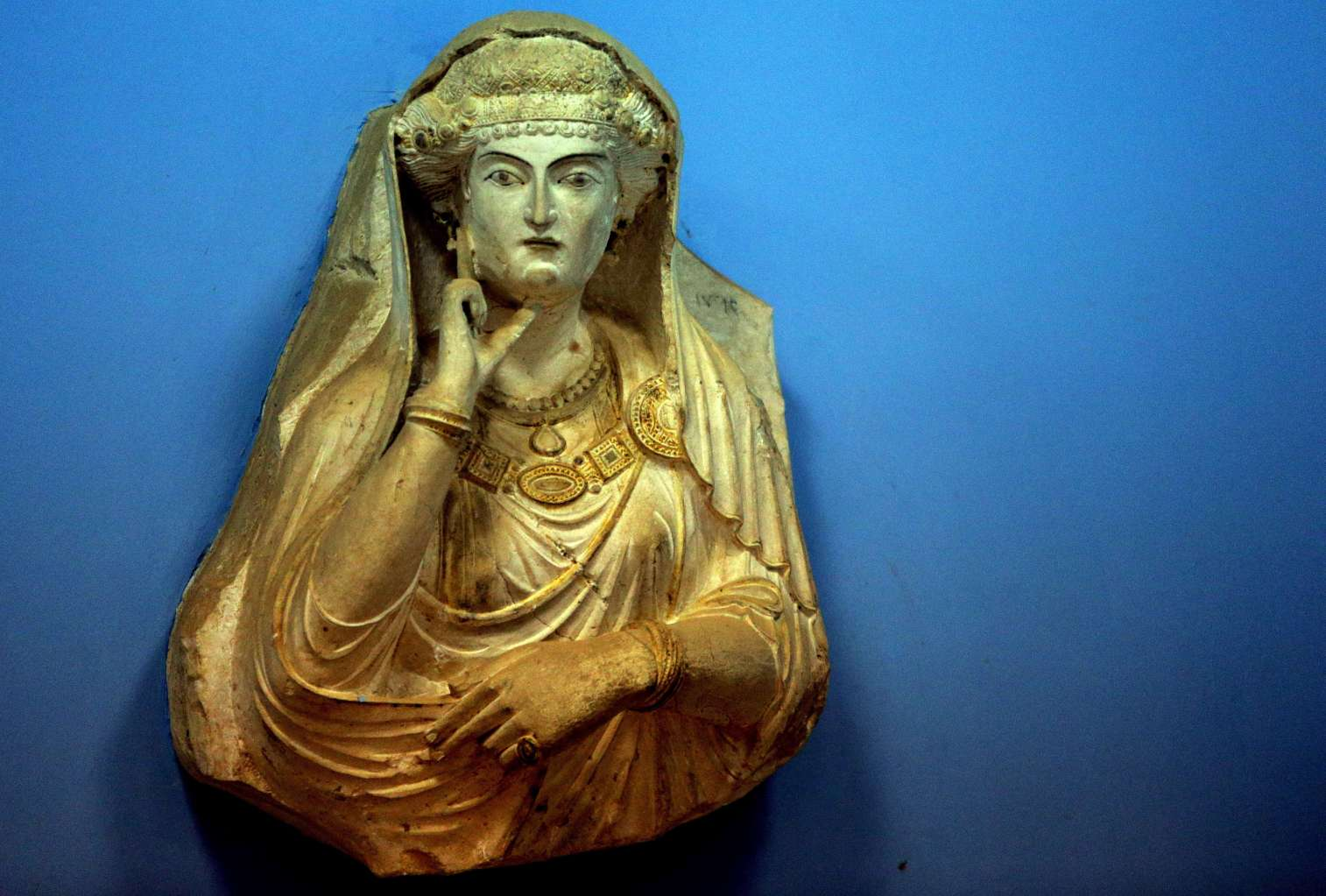 A picture taken on March 14, 2014 shows a sculpture found in the ancient Syrian oasis city of Palmyra, 215 kilometres northeast of Damascus, and now displayed at the city's museum. From the 1st to the 2nd century, the art and architecture of Palmyra, standing at the crossroads of several civilizations, married Graeco-Roman techniques with local traditions and Persian influences. AFP PHOTO/JOSEPH EID        (Photo credit should read JOSEPH EID/AFP/Getty Images)
