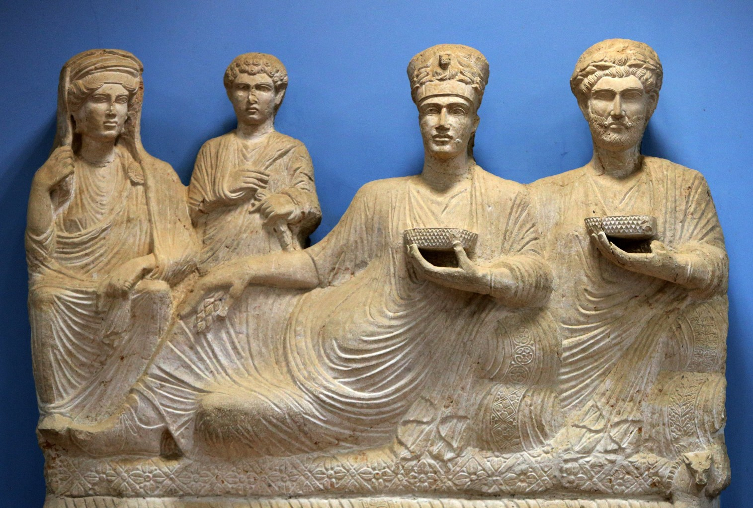 A picture taken on March 14, 2014 shows a sculpture depicting a rich family from the ancient Syrian oasis city of Palmyra, 215 kilometres northeast of Damascus, displayed at the city's museum. From the 1st to the 2nd century, the art and architecture of Palmyra, standing at the crossroads of several civilizations, married Graeco-Roman techniques with local traditions and Persian influences. AFP PHOTO/JOSEPH EID        (Photo credit should read JOSEPH EID/AFP/Getty Images)
