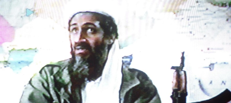 "AL-FAROUQ BASE, AFGHANISTAN:  A video grab dated 19 June 2001 shows Saudi dissident Osama bin Laden in a video tape said to have been prepared and released by bin Laden himself. Copies of the tape, which shows members of bin Laden's organization Al-Qaeda, or ""The Base"", training at their al-Farouq base in Afghanistan, have been circulated to a limited number of Islamists. (Photo credit should read AFP/Getty Images)"
