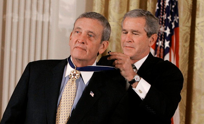 WASHINGTON - DECEMBER 14:  U.S. President George W. Bush (R) presents the Medal of Freedom to retired U.S. General Tommy Franks (L) during a ceremony in the East Room at the White House, December 14, 2004 in Washington, DC. Bush honored former administrator of the Coalition Provisional Authority Paul Bremer, Former General Tommy Franks and former CIA Director George Tenet with the nations highest civilian honor.  (Photo by Mark Wilson/Getty Images)