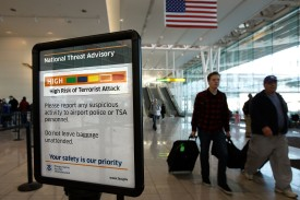 """BALTIMORE - DECEMBER 28:  A sign telling passengers that the National Threat Advisory is at Level """"Orange,"""" or high, is posted outside a security screening area at Baltimore Washington International Airport December 28, 2009 in Baltimore, Maryland. A passenger was detained after flying yesterday evening from BWI to New York La Guardia Airport with a 4-inch-long firework. Security measures have been heightened at airports after a Nigerian man attempted a terrorist attack on a Northwest Airlines flight on Christmas Day in Detroit.  (Photo by Chip Somodevilla/Getty Images)"""