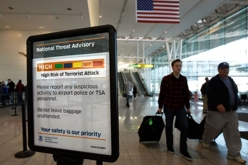 "BALTIMORE - DECEMBER 28:  A sign telling passengers that the National Threat Advisory is at Level ""Orange,"" or high, is posted outside a security screening area at Baltimore Washington International Airport December 28, 2009 in Baltimore, Maryland. A passenger was detained after flying yesterday evening from BWI to New York La Guardia Airport with a 4-inch-long firework. Security measures have been heightened at airports after a Nigerian man attempted a terrorist attack on a Northwest Airlines flight on Christmas Day in Detroit.  (Photo by Chip Somodevilla/Getty Images)"