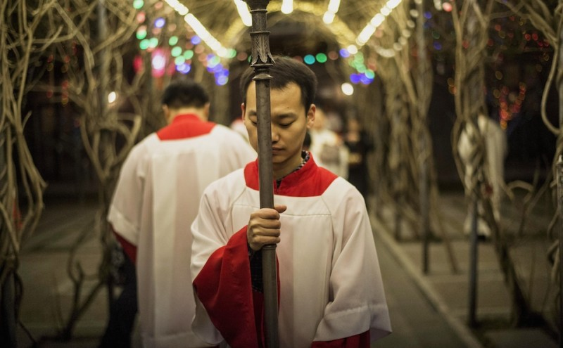 A young Chinese worshipper attends the Christmas Eve mass at a Catholic church in Beijing on December 24, 2014 as Christians around the world prepare to celebrate the holy day.  AFP PHOTO / FRED DUFOUR        (Photo credit should read FRED DUFOUR/AFP/Getty Images)