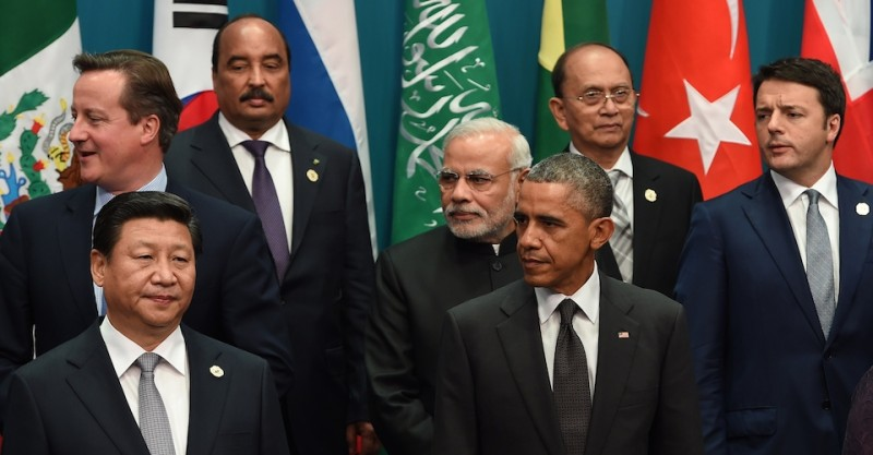 """(L to R) Britain's Prime Minister David Cameron, China's President Xi Jinping, Mauritania's President Mohamed Ould Abdel Aziz, India's Prime Minister Narendra Modi, US President Barack Obama, Myanmar President Thein Sein and Italy's Prime Minister Matteo Renzi join other heads of states and international organizations to pose for a """"family photo"""" during the G20 Summit in Brisbane on November 15, 2014. Australia is hosting the leaders of the world's 20 biggest economies for the G20 summit in Brisbane on November 15 and 16.     AFP PHOTO / Saeed KHAN        (Photo credit should read SAEED KHAN/AFP/Getty Images)"""