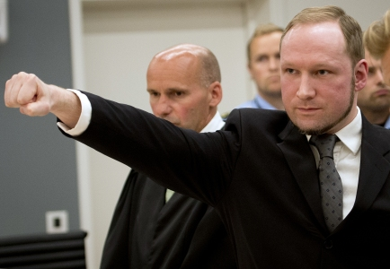 """(FILES) - Picture taken t on August 24, 2012 shows self confessed mass murderer Anders Behring Breivik raising his fist in a right wing salute after being sentenced to 21 years in prison, in court room 250 at Oslo District Court. The newspaper Aftenposten revealed on May 10, 2013 that Breivik had applied to create a party he wished to call """"The Norwegian Fascist Party and the Nordic League"""" but permission was denied. AFP PHOTO / ODD ANDERSEN        (Photo credit should read ODD ANDERSEN/AFP/Getty Images)"""