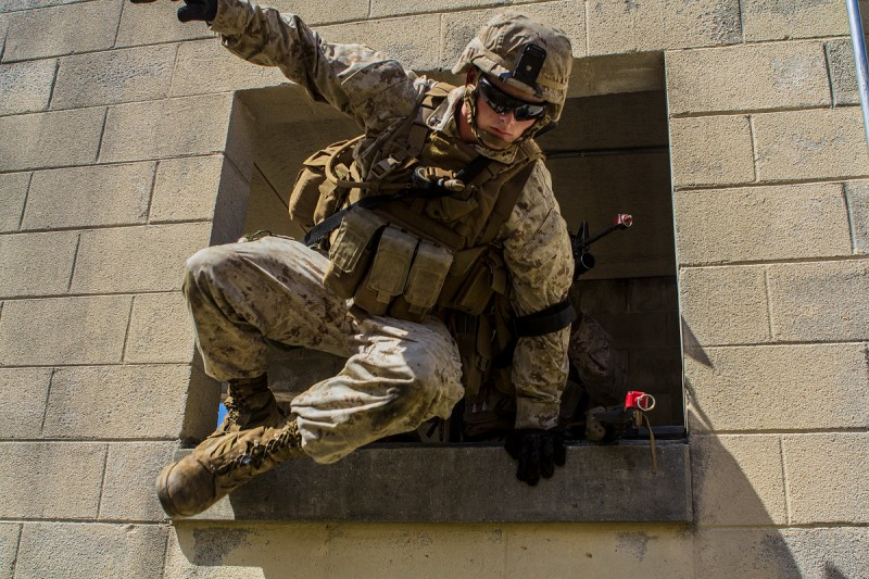 U.S. Marines with Golf Company, Battalion Landing Team 2/6, 26th Marine Expeditionary Unit (MEU), exit a building through a window during military operations in urban terrain training, at Fort Pickett, Va., April 11, 2015. The 26th MEU and its supporting elements are conducting realistic urban training in preparation for deployment to the 5th and 6th Fleet areas of responsibility later this year. (U.S Marine Corps Photo by Cpl. Jalen D. Phillips/Released)