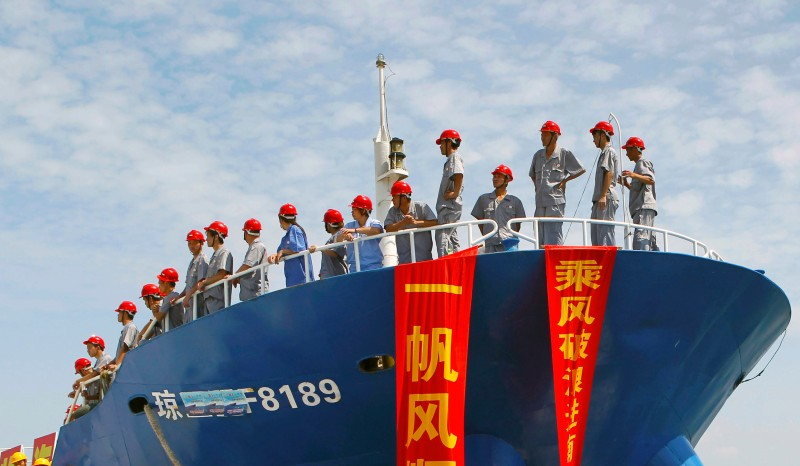 This picture taken on May 6, 2013 shows staff standing on a fishing vessel setting sail for the Spratly Islands, an archipelago disputed between China and other countries including Vietnam and the Philippines, from Danzhou, south China's Hainan province. China has sent one of its largest recorded fishing fleets to disputed islands in the South China Sea, state-run media said on  May 7, amid tensions over Beijing's assertion of its claims in the region. CHINA OUT     AFP PHOTO        (Photo credit should read STR/AFP/Getty Images)