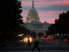 WASHINGTON, DC - OCTOBER 17:  The sun begins to rise behind the U.S. Capitol building on the morning after a bipartisan bill was passed by the House and the Senate to reopened the government and raise the debt limit, on October 17, 2013 in Washington, DC. President Obama signed the bill into law, that will fund the government until January 15, 2014 and allow the government to pay bills until February 7, 2014.  (Photo by Mark Wilson/Getty Images)