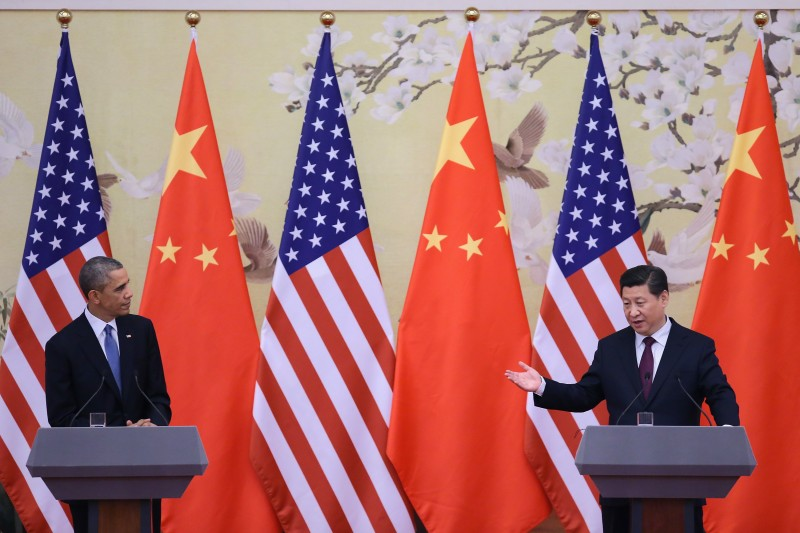 BEIJING, CHINA - NOVEMBER 12:  U.S. President Barack Obama (L) and Chinese President Xi Jinping (R) attend a press conference at the Great Hall of People on November 12, 2014 in Beijing, China. U.S. President Barack Obama pays a state visit to China after attending the 22nd Asia-Pacific Economic Cooperation (APEC) Economic Leaders' Meeting.  (Photo by Feng Li/Getty Images)
