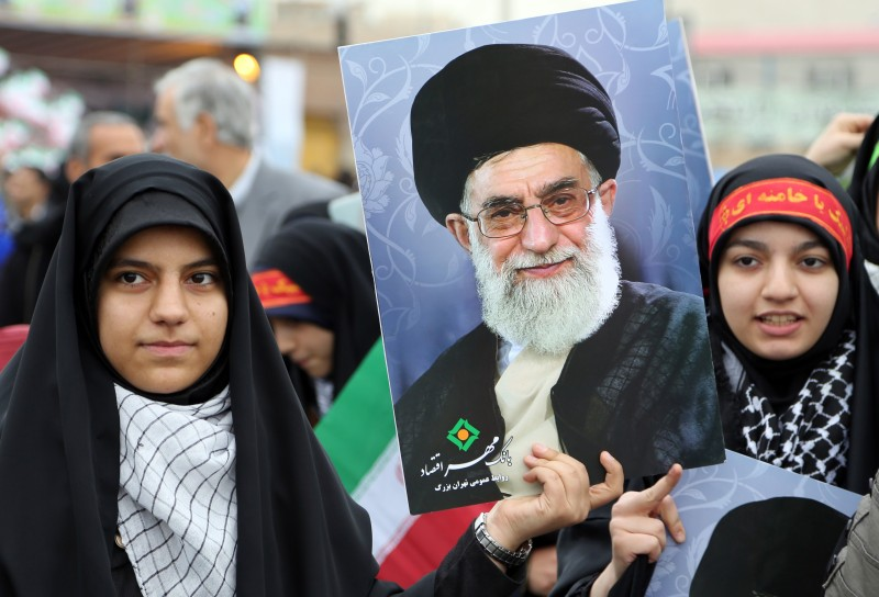 Iranian women hold posters of Iran's Supreme Leader Ali Khamenei during a rally in Tehran on Feb. 11, 2015.