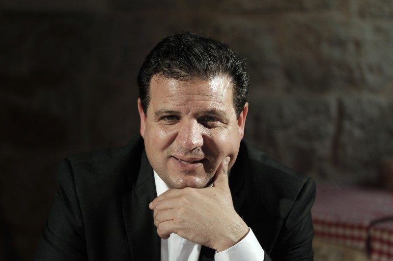 Israeli Arab political leader Ayman Odeh gestures during a press conference in Jerusalem on March 9, 2015 as part of his election campaign ahead of the March 17 general elections. The Arab list, which polls show could win 12 seats in the election, one more than their combined total now, includes Muslim, Christian, Druze and even Jewish Communist candidates. It comprises the Balad party, the Islamic Movement, the Arab Movement for Change, and Hadash, an Arab-Jewish socialist party. AFP PHOTO / AHMAD GHARABLI        (Photo credit should read AHMAD GHARABLI/AFP/Getty Images)