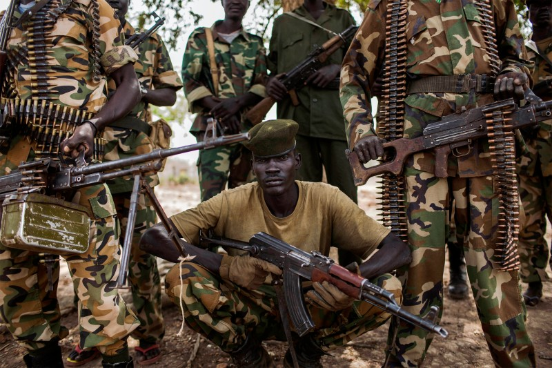 Sudan People's Liberation Army (SPLA) government soldiers from the 2nd Battalion pose at the SPLA headquarters in Nyang, in the county of Yirol East, South Sudan, on February 15, 2014. Fighting between forces loyal to South Sudanese President Salva Kiir and former vice president Riek Machar erupted on December 15, sparking heavy clashes across the country that have left thousands dead and displaced close to 900,000 people. AFP PHOTO / FABIO BUCCIARELLI        (Photo credit should read FABIO BUCCIARELLI/AFP/Getty Images)