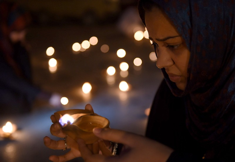 An activist of Pakistan Muslim League-Q holds oil lamps during a vigil for the victims of an attack by gunmen on a Shiite Ismaili minority bus, in Karachi on May 15, 2015. The United States offered to help Pakistan investigate a deadly Karachi bus attack which left 44 Shiite Ismailis dead, in the first assault in the country claimed by the Islamic State group.   AFP PHOTO/ Asif HASSAN        (Photo credit should read ASIF HASSAN/AFP/Getty Images)