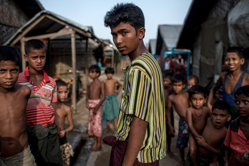 SITTWE, BURMA - MAY 25:  Anis, 18 years, was held captured by human traffickers at sea for 32 days, May 25, 2015 in Sittwe, Burma. Since 2012, the minority group of the Rohingya people are forced to live in IDP camps, in Rakhaing State in western Burma. They have been denied citizenship in their homeland Burma and are accused of being illegal migrants from neighbouring Bangladesh. Thousands of Rohingays try to escape the misery in the IDP camps across the Andaman Sea on small fishing boats hoping to reach Malaysia. Many of those who embark on the perilous journey by sea fall into the hands of human traffickers who charge high prices in return for their freedom.  (Photo by Jonas Gratzer/Getty Images)