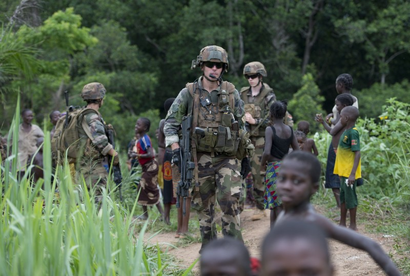 French soldiers of the 13th Alpine Hunters Battalion (13th BCA) patrol near the northwestern city of Boda on April 7, 2014. Thousands of people have been killed in a wave of sectarian violence across the Central African Republic that has lasted for more than a year, despite the presence of African Union and French peacekeeping troops. AFP PHOTO/MIGUEL MEDINA        (Photo credit should read MIGUEL MEDINA/AFP/Getty Images)