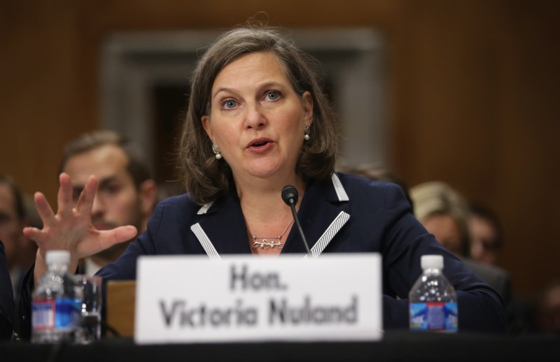 "WASHINGTON, DC - MAY 06:  Assistant Secretary of State for European and Eurasian Affairs Victoria Nuland testifies during a hearing before the Senate Foreign Relations Committee May 6, 2014 on Capitol Hill in Washington, DC. The committee held a hearing on ""Ukraine - Countering Russian Intervention and Supporting a Democratic State.""  (Photo by Alex Wong/Getty Images)"
