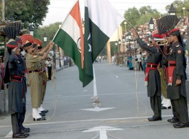406027 01: Soldiers From India (L) And Pakistan (R) Perform The Elaborate Daily Flag-Lowering Ceremony May 30, 2002 At The Wagah Border Post Near The Pakistani City Of Lahore. Pakistan And India Are Locked In A Tense Border Standoff And Have Amassed Nearly A Million Soldiers Near The 160-Mile Line Of Control In Kashmir. The Loc Has Been The Defacto Border Between The Two Nuclear Powers Since The End Of Their First War In 1948. (Photo By Visual News/Getty Images)