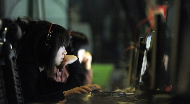 "TO GO WITH China-politics-Internet,FEATURE by Pascale Trouillaud   This photo taken on May 11, 2011 shows a Chinese young woman surfing the net at an Internet bar in Beijing. China, which employs an army of censors to police the Internet, has also deployed legions of ""web commentators"" to get the government's message out -- in a crafty but effective way.     AFP PHOTO / GOU Yige (Photo credit should read GOU YIGE/AFP/Getty Images)"