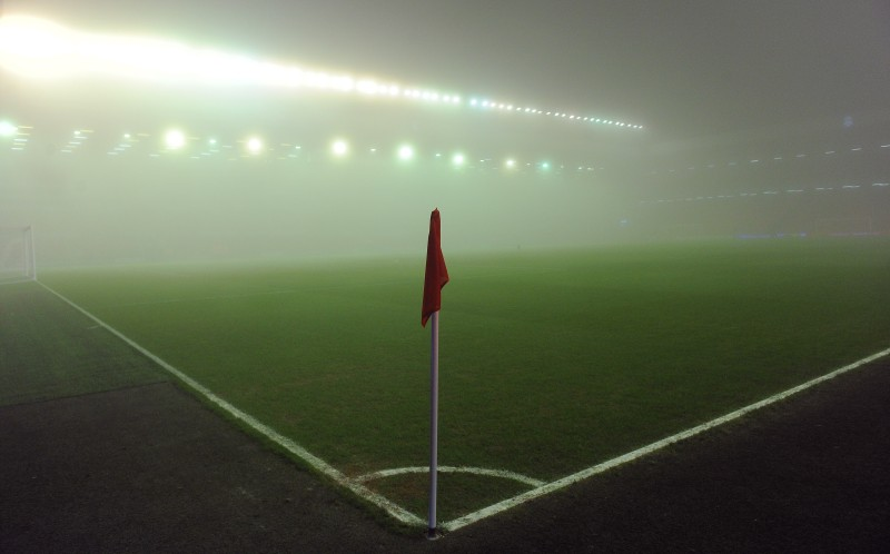 Fog gathers in the stadium prior to the English Premier league football match between Liverpool and Tottenham Hotspur at Anfield in Liverpool, north-west England on February 6, 2012. AFP PHOTO/ANDREW YATES. RESTRICTED TO EDITORIAL USE. No use with unauthorized audio, video, data, fixture lists, club/league logos or ?live? services. Online in-match use limited to 45 images, no video emulation. No use in betting, games or single club/league/player publications. (Photo credit should read ANDREW YATES/AFP/Getty Images)