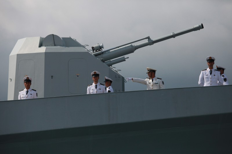 Chinese navy servicemen stand at the ready next to a large armament, onboard the Chinese missile frigate Yuncheng (571) in Hong Kong on April 30, 2012. A missile destroyer and a missile frigate is making a port call in Hong Kong to commemorate the 15th anniversary of Hong Kong's handover from the Britain to China.  AFP PHOTO / AARON TAM        (Photo credit should read aaron tam/AFP/GettyImages)
